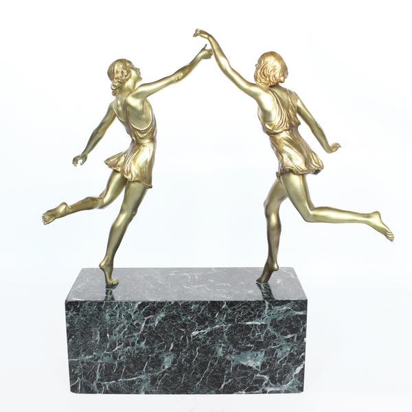 'Springtime', an Art Deco gilt bronze sculpture of a pair of dancers in Grecian dress, set over a marble plinth with gilt bronze detail at Jeroen Markies