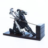 Don Quixote Bookends. Walnut and silver-plated metal in the style of Hagenauer