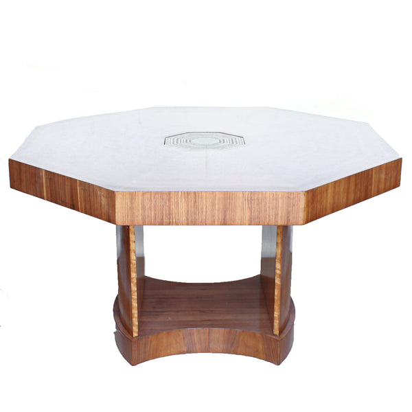 An Art Deco, octagonal dining/centre table in walnut and satin wood veneer with original light in the centre.