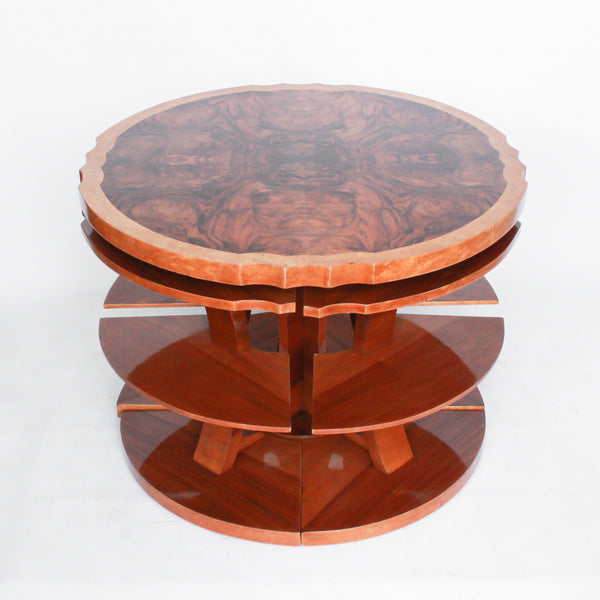 Art Deco, figured walnut veneer nest of tables. A shaped table with cross-footed base and four integral side tables. Burr and straight grain walnut throughout with birdseye maple border.