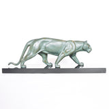 An Art Deco, patinated bronze study of a prowling lioness, mounted on a black marble base. Signed 'M. Leduc' at Jeroen Markies.