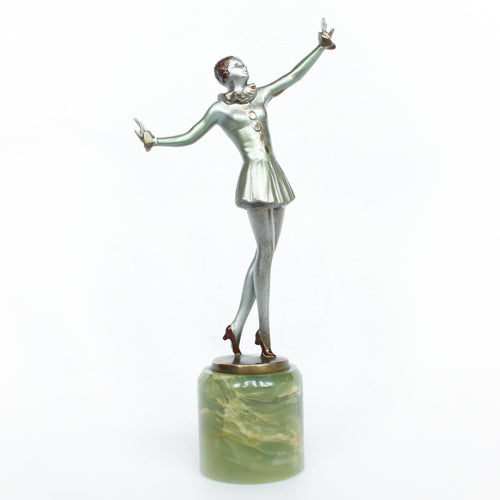 An Art Deco, cold painted bronze figure of an elegant dancer in a striking pose, raised on a green onyx base.  Signed Lorenzl to bronze