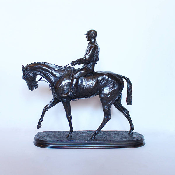 Vainqueur du Derby, a patinated bronze jockey on his horse by Pierre-Jules Mene at Jeroen Markies