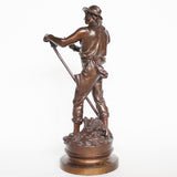 An early 20thC patinated bronze figure of a field worker by Mathurin Moreau at Jeroen Markies