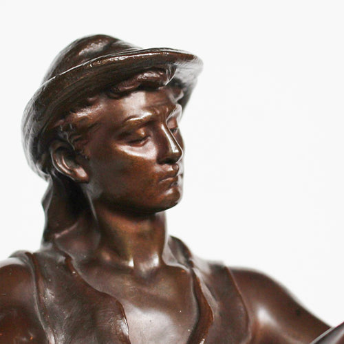 An early 20thC, patinated bronze sculpture of a field worker sharpening his scythe. Signed Math Moreau to base and stamped Medaille D'honeur at Jeroen Markies