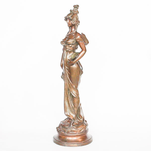 Odalisque, an Art Nouveau patinated spelter sculpture of a scantily clad young lady flanked by flowering vines. Signed Nanteuil to cast, and with title plaque to front at Jeroen Markies