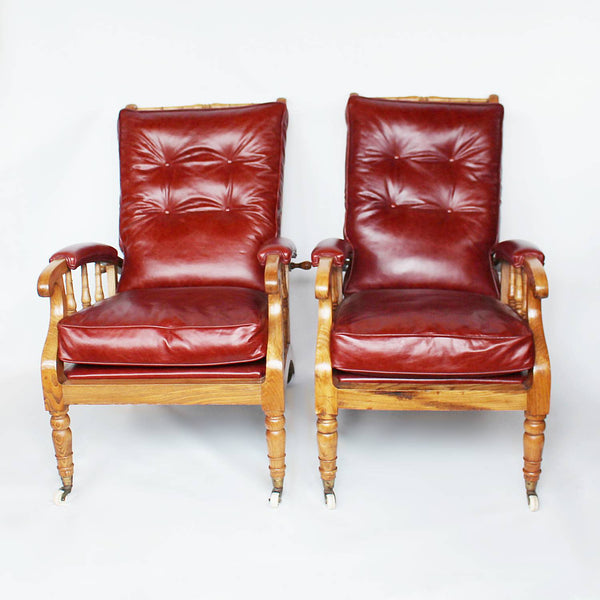 A pair of Philip Webb Arts & Crafts reclining armchairs circa 1900