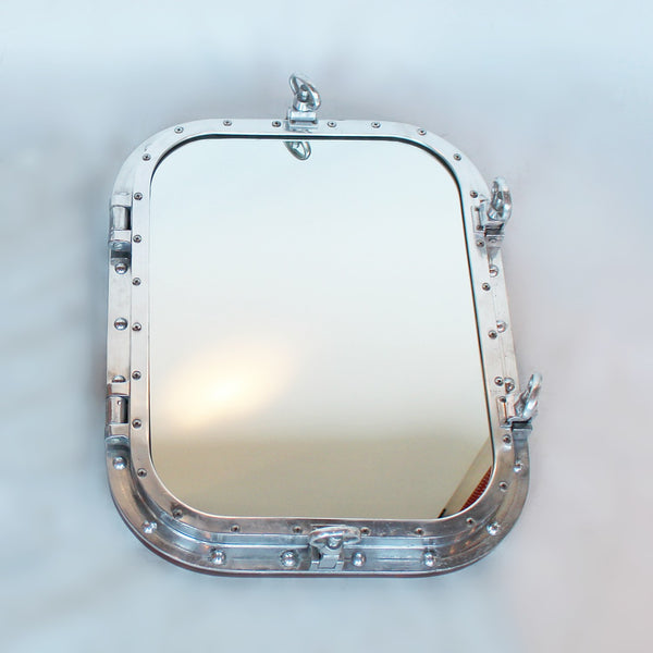 Art Deco porthole transformed into opening mirror at Jeroen Markies