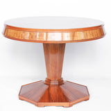 Round centre table in veneered walnut with octagonal base and central column. Table top veneered in quartered figured walnut with solid walnut edging at Jeroen Markies