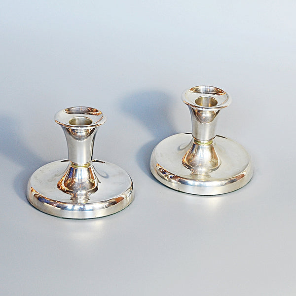 A Pair of Silver Dwarf Candlesticks