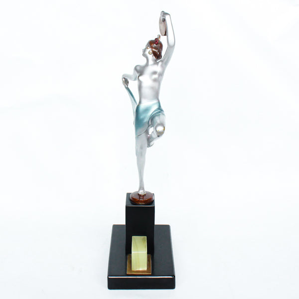 An Art Deco, cold painted bronze figure of an elegant dancer holding a tambourine, raised on a green onyx base.  Signed Lorenzl to bronze