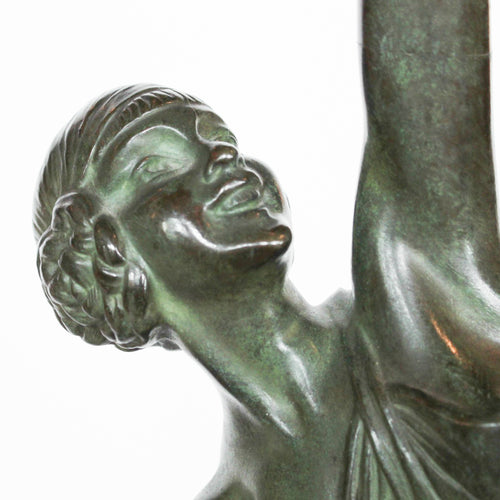Diana, an Art Deco silvered bronze sculpture depicting Diana the Huntress. Shown in stylised pose, holding a bow aloft at Jeroen Markies