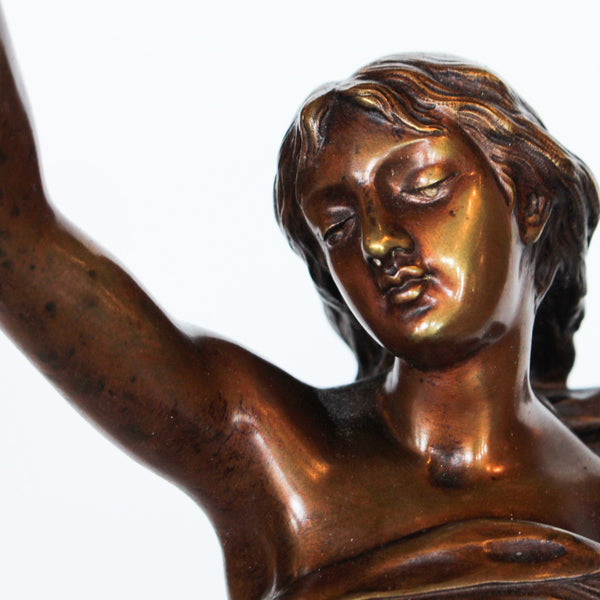 L'Etoile du Matin, an Art Nouveau patinated bronze sculpture of a mythological lady in flowing robes holding aloft a star, perched on a globe decorated with symbols of the zodiac and a sprig of roses at Jeroen Markies
