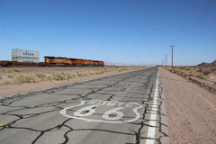 Route 66 and a freight train running left to the street