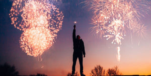 Fireworks and man with resolutions or New Year's resolutions for more power, energy, health, focus and performance