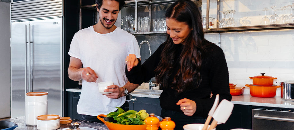 couple cooks together in the kitchen
