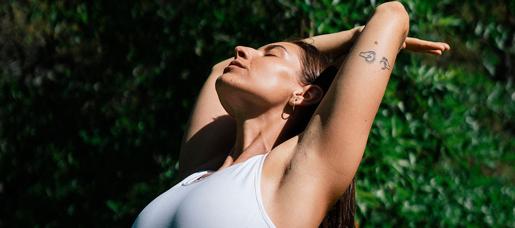 woman stretches in the sun