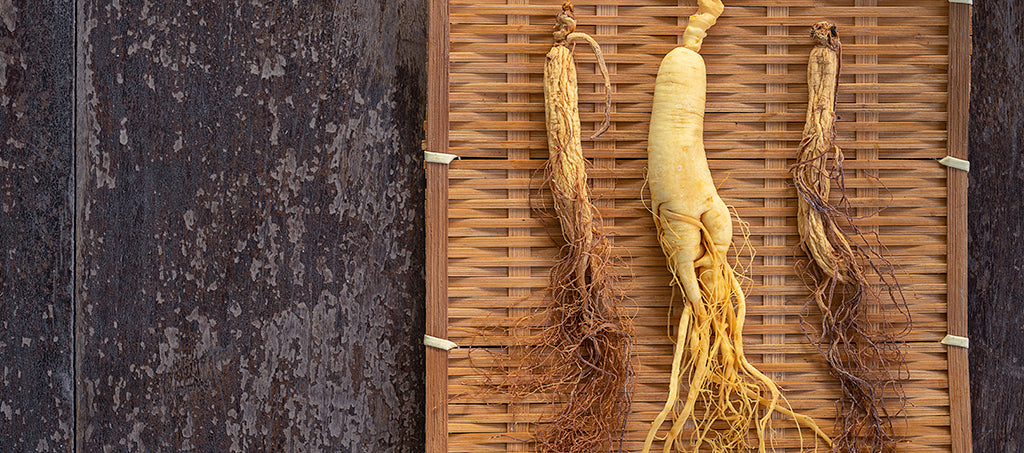 ginseng roots on a wooden board