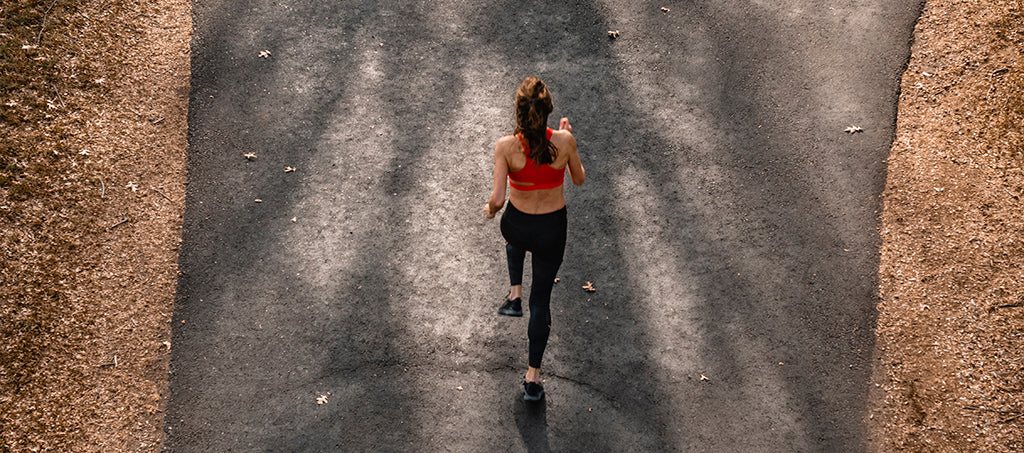 Woman goes jogging outside in the forest