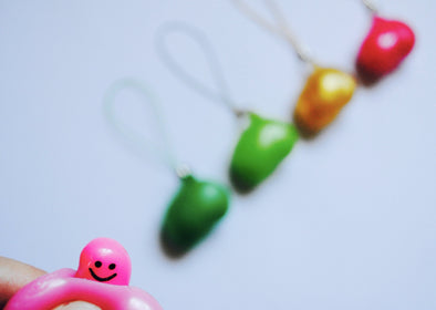 Peeping bean squeezable phone charm