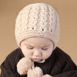 Knitted Lace Up Baby Bonnet with Pompoms
