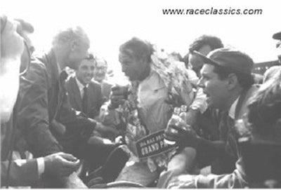 Peter Collins celebrates with Mike Hawthorn
