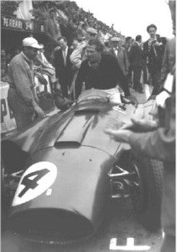 Peter Collins exits the Lancia-Ferrari D50