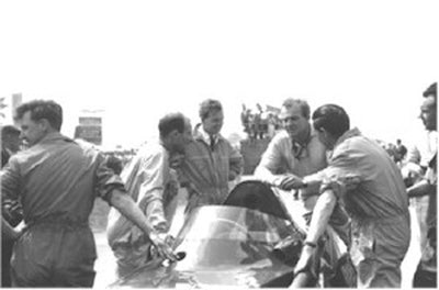 Harry Schell with Stirling Moss and Rivers Fletcher