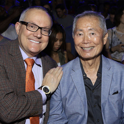 George Takei attends the KYBOE! fashion show with partner Brad Takei.