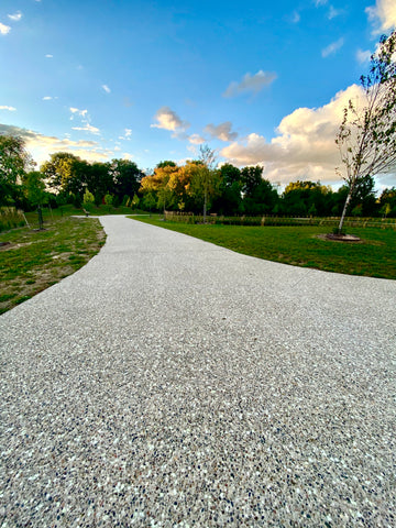 Glowing exposed aggregate concrete surface creating a beautiful glowing trail