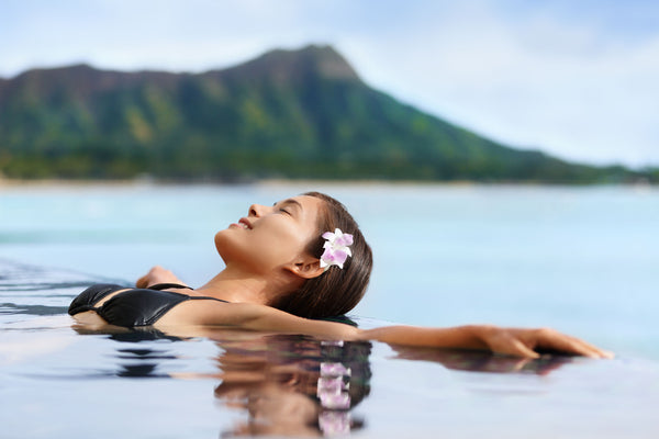 Young woman relaxing on Oahu shores