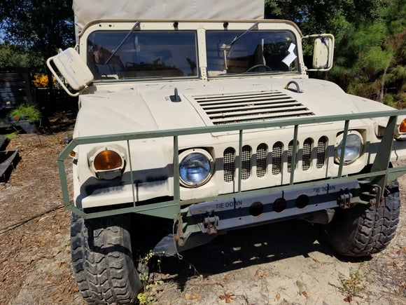 Humvee M998 The 1986 2 door M998  with brush guard is a 6.5L with 10,486 Miles