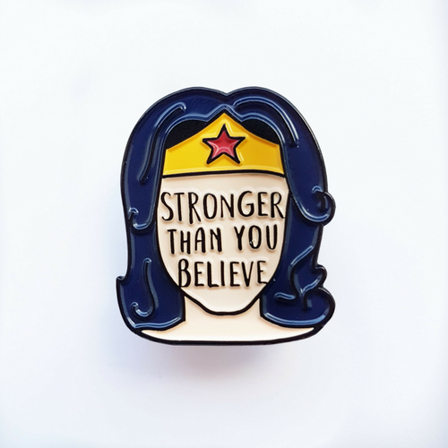 stronger than you believe enamel pin bookish and bakewell wonder woman