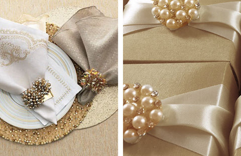 Reception place setting and gift boxes decorated with amber rhinestone brooches.