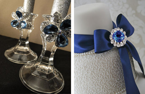 Candlesticks and wedding cake decorated with blue rhinestone brooches.