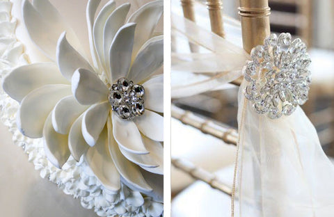 Large rhinestone brooches are used as chair décor to create a gorgeous wedding aisle.