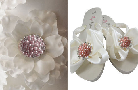 Pink rhinestone brooches are attached to flip flops and silk flowers to create a romantic feel.