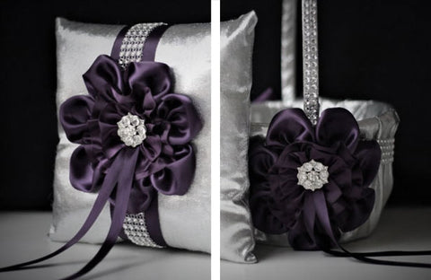 A flower girl basket and matching ring bearer pillow are decorated with clear rhinestone brooches.