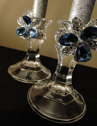 Blue rhinestone brooches create a stunning look on candle holders purchased from the Dollar Store.
