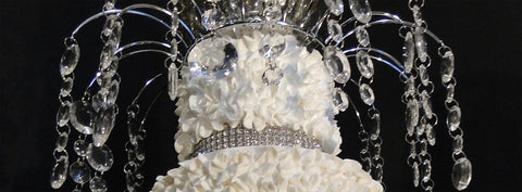 A beautiful cake topper with hanging crystals for your wedding cake.
