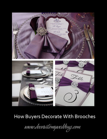 Rhinestone brooches are used to create table numbers and napkin rings.