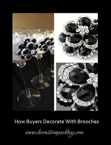Tall stem candle holders are decorated with black and silver rhinestone brooches.