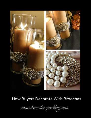 Tall clear cylinder candle holders are decorated with pearl brooches.