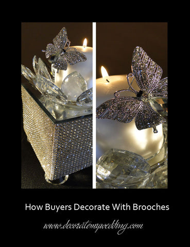 A butterfly shaped brooch is attached to a pillar candle creating a stunning effect.