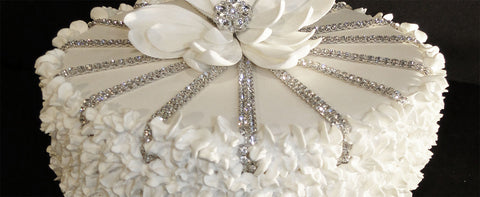 The spiral rhinestone rows are fully integrated into the ruffles around the sides of the faux cake.