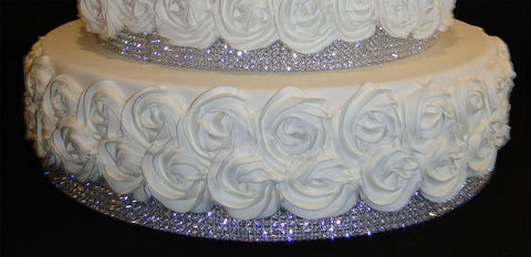 The sparkling rhinestone banding trim is part of the faux cake layer.