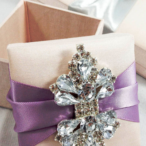 Think outside the box – be creative when using rhinestone brooches to decorate your wedding.
