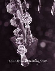 Large diamond pendants and rhinestone embellishments hang from a silver wedding tree.