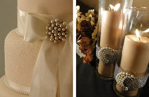 Wedding cake and cylinder candles decorated with pearl brooches.