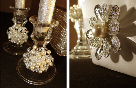 Candlesticks and flower girl baskets decorated with pearl brooches.